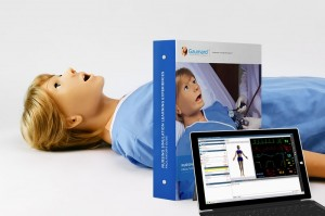 SUSIE patient simulator in hospital gown with SLE scenario guide and wireless control tablet